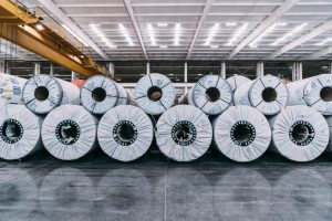 Rolls of steel coils stacked using the Lankhosrt Roll-Stop system at a manufacturing plant.