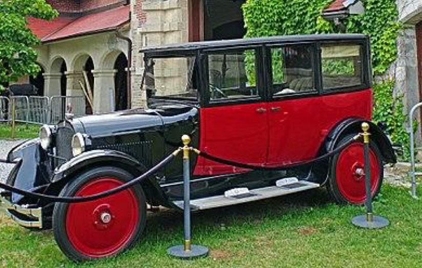 An original Dennis Jarvis picture showing the thirty-five horsepower 1924 Dodge Model D2 Touring Sedan composed of an all-steel body painted black and red with a rectangular carriage and elongated hood.