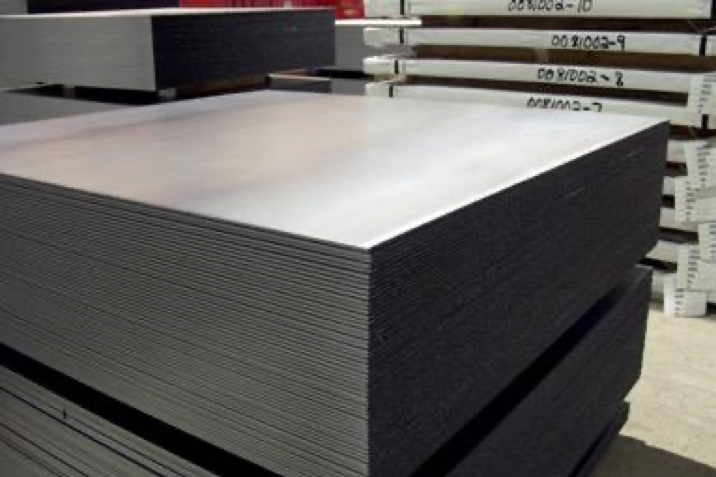 A stack of thin, cut-to-length square-shaped sheets of steel.